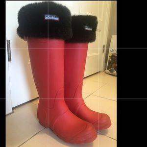 Bright coral Hunter rain boots